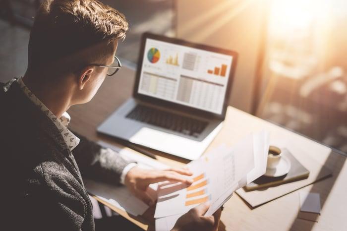 An investor checks his stock portfolio on a laptop.