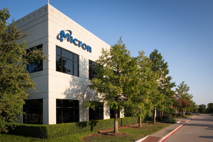 A building with a Micron logo with trees around it.
