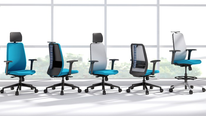 Five Steelcase office chairs.