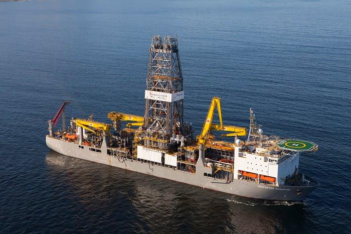 Drilling rig ship at sea with Transocean logo.