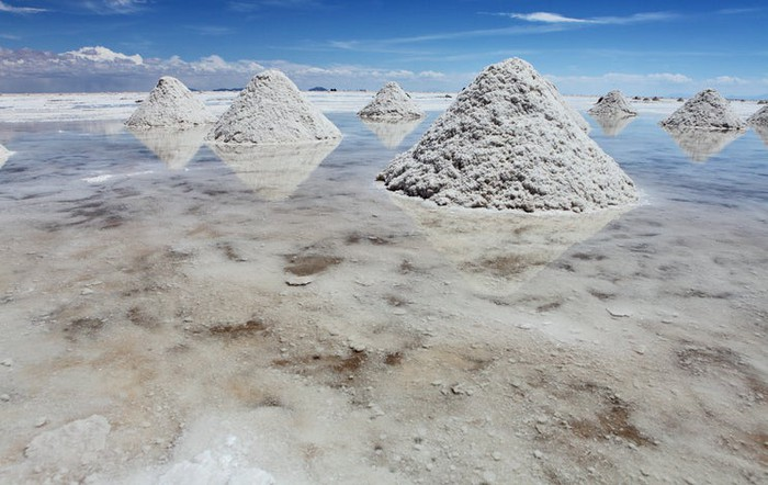 A salt lake with piles of lithium. Blue sky in background.