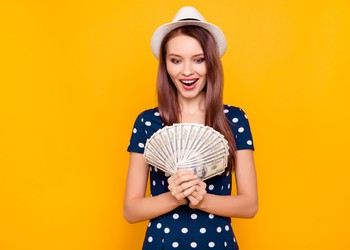 Excited girl with money and summer dress