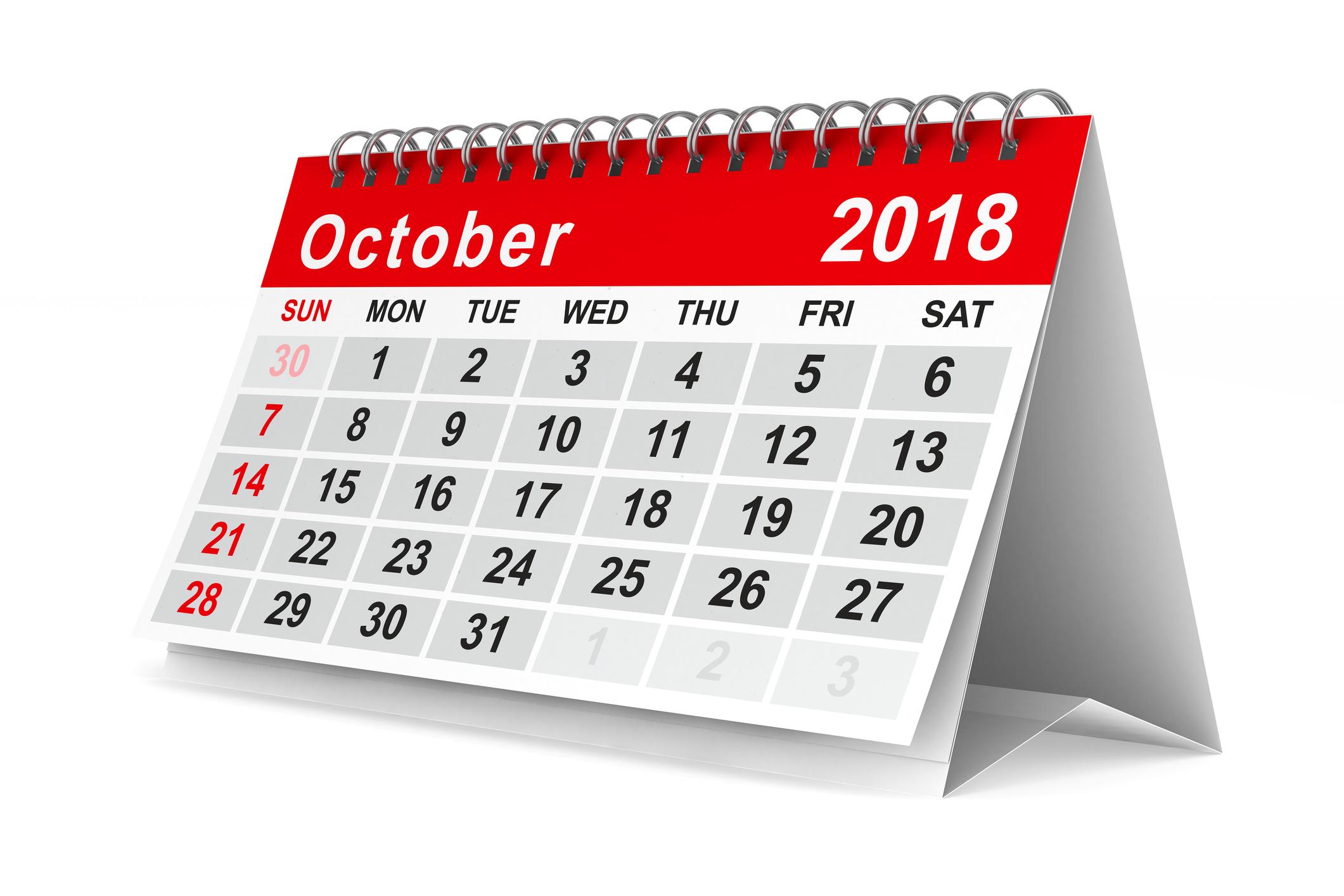 An October 2018 calendar standing on a surface.