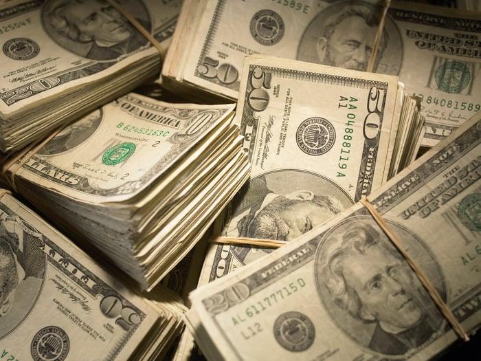 Wads of dollar bills.
