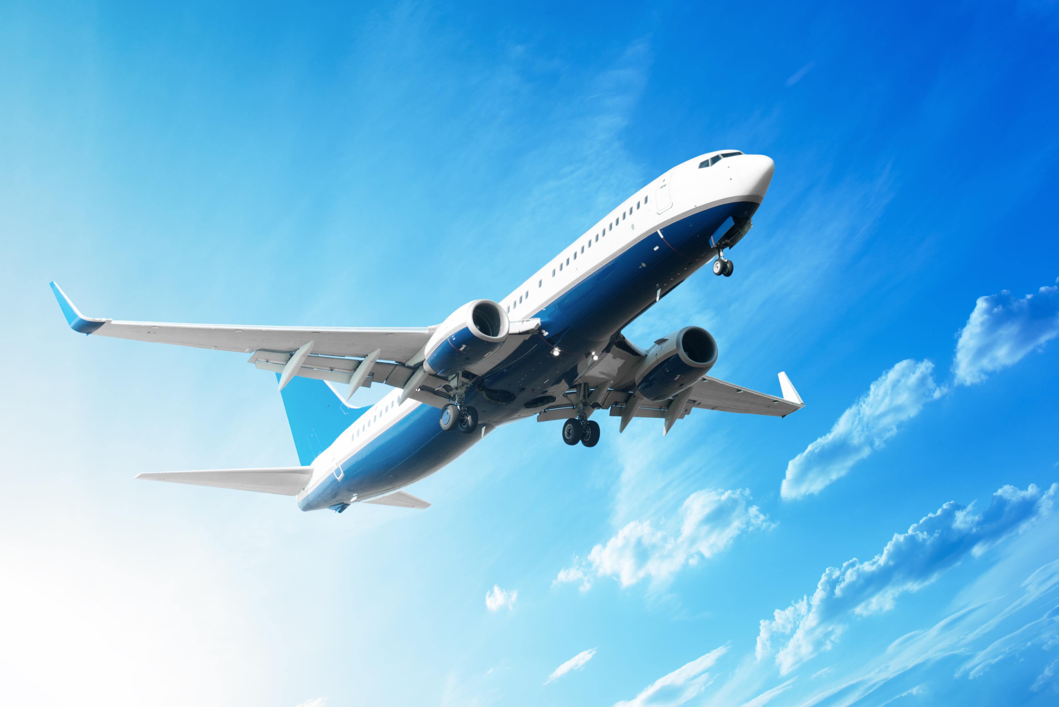 A passenger plane soaring into the sky.
