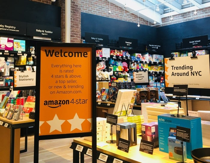 Interior of an Amazon store with a sign indicating that everything in the store is rated 4 stars or higher, a top seller, or trending on Amazon.com.