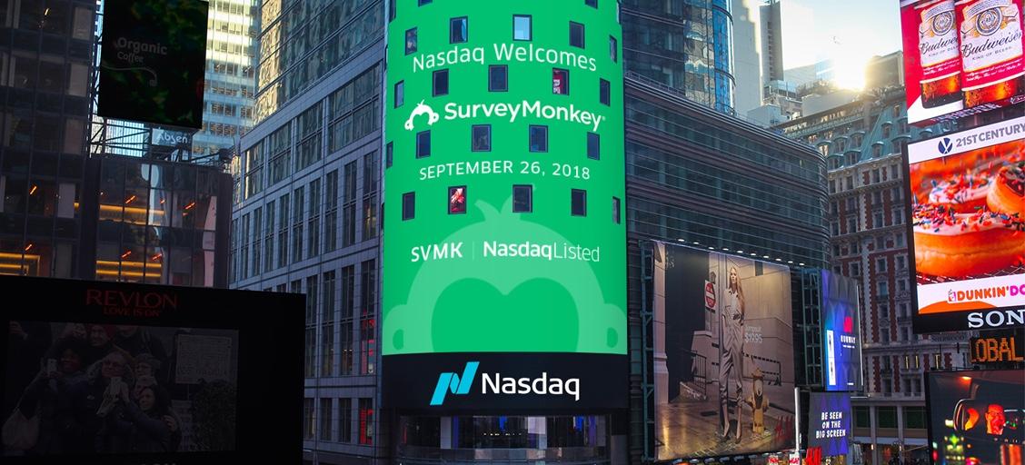 "A digital banner reads ""Nasdaq Welcomes SurveyMonkey September 26, 2018. SVMK Nasdaq Listed."""