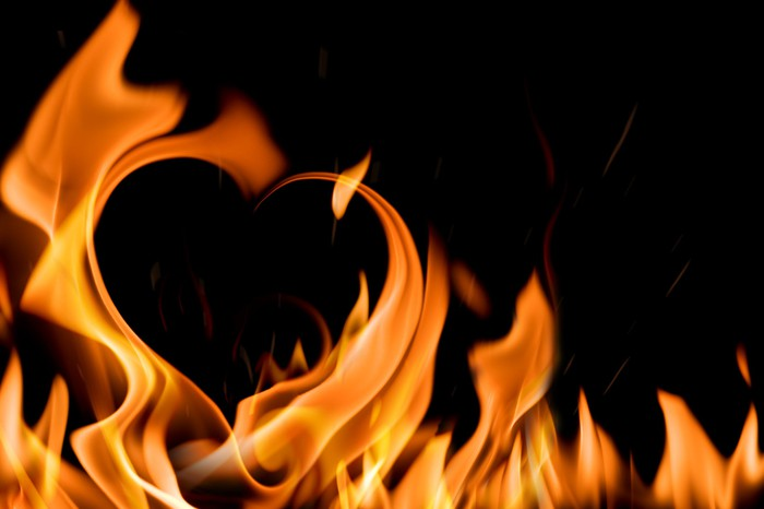 The image of a heart formed by flames.