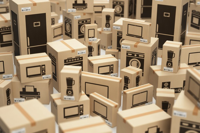 Miniature boxes of home goods and appliances.