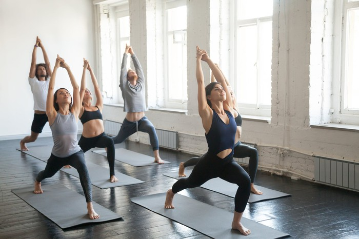 People doing yoga in a studio.