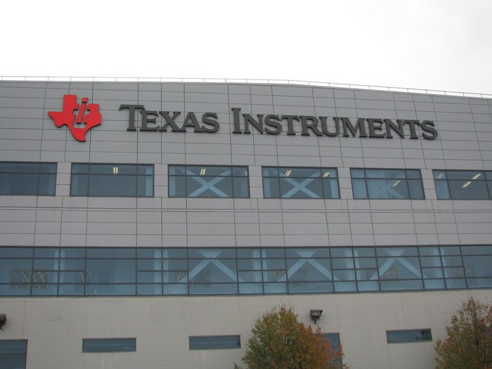 A building with the Texas Instruments corporate logo displayed.