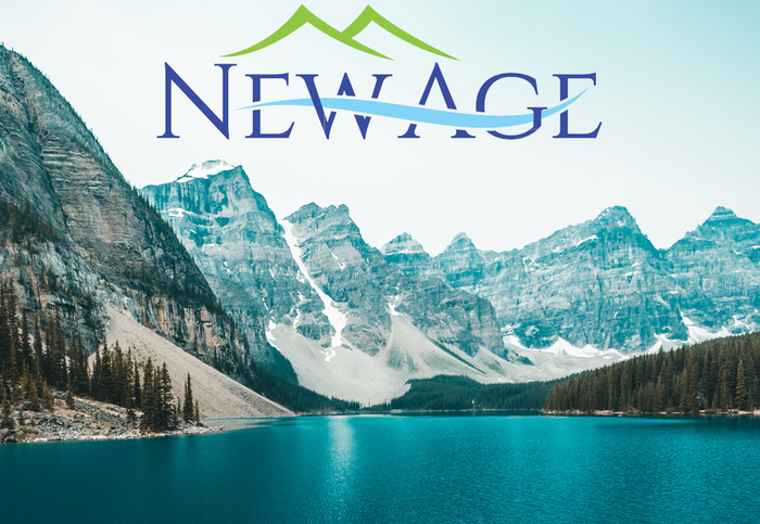 Glacial lake in front of snowy mountains with New Age logo in the sky