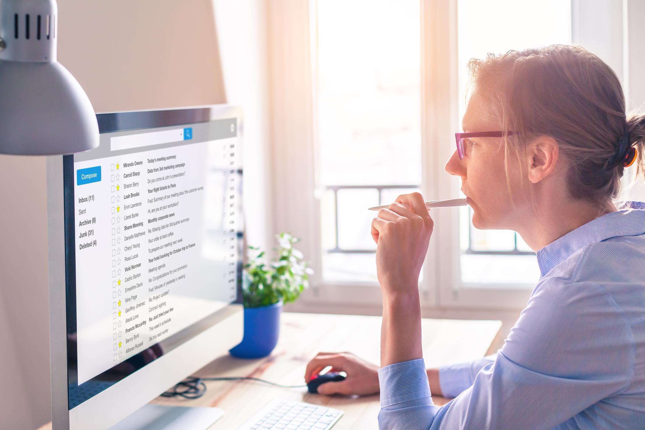 A woman at work at a computer.