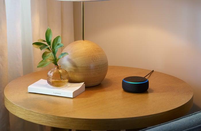 Amazon Echo Dot sitting on a table.