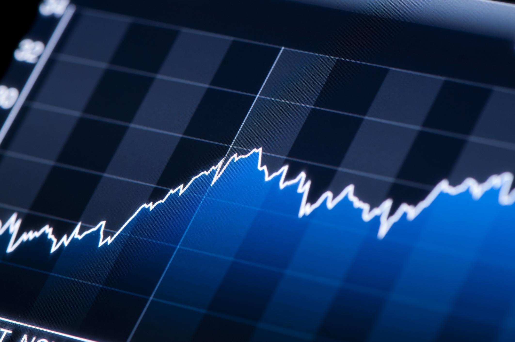 Stock chart with upward trajectory.