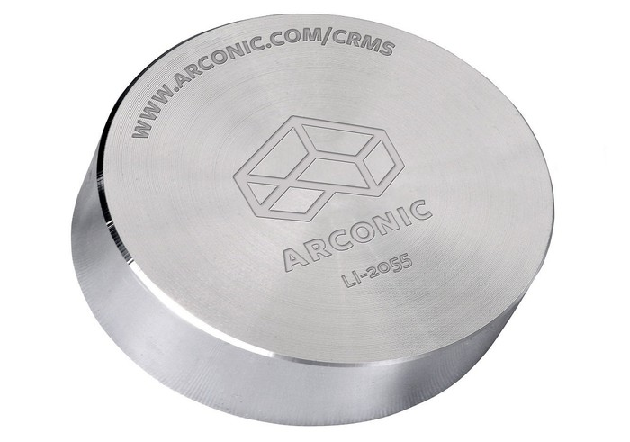 Cylinder of fabricated silver-colored metal with Arconic logo on it.