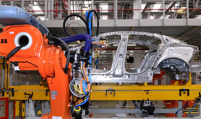 A Jaguar XE sedan's frame is shown on an assembly line at a factory in Castle Bromwich, England.