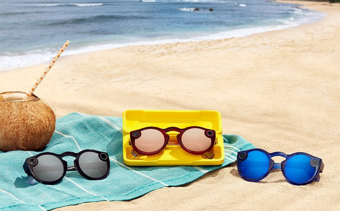Three pairs of Spectacles 2 on a beach towel on a beach