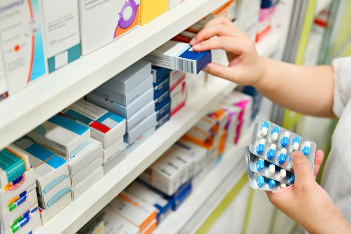 Shelves of medications in a pharmacy.