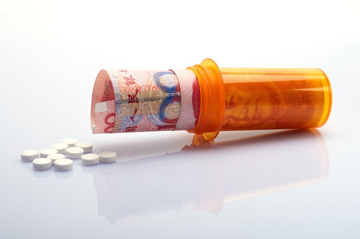Chinese currency in a pill bottle.