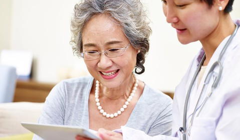 senior-asian-woman-and-doctor-getty
