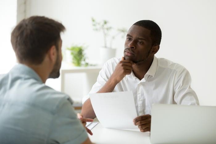 Two professional men having a serious conversation.