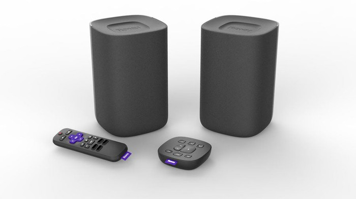 A pair of wireless Roku speakers with a voice a remote and tabletop remote.