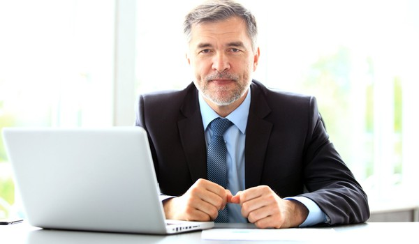 older man in suit at laptop_GettyImages-909286824