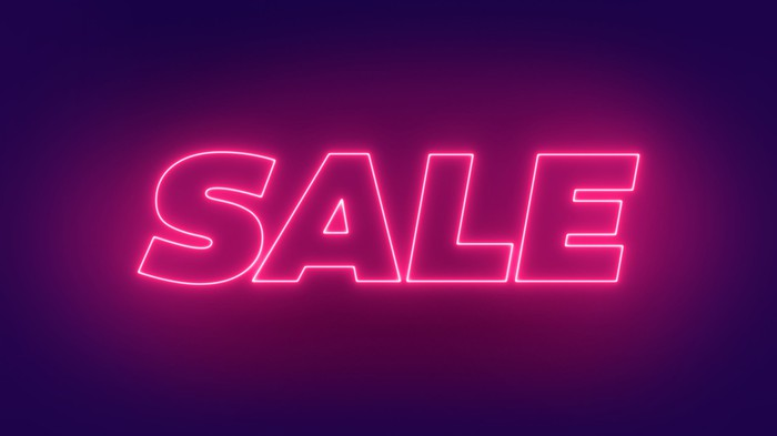 A purple neon sign with the word sale.
