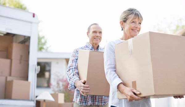 senior couple with moving boxes_GettyImages-135385160