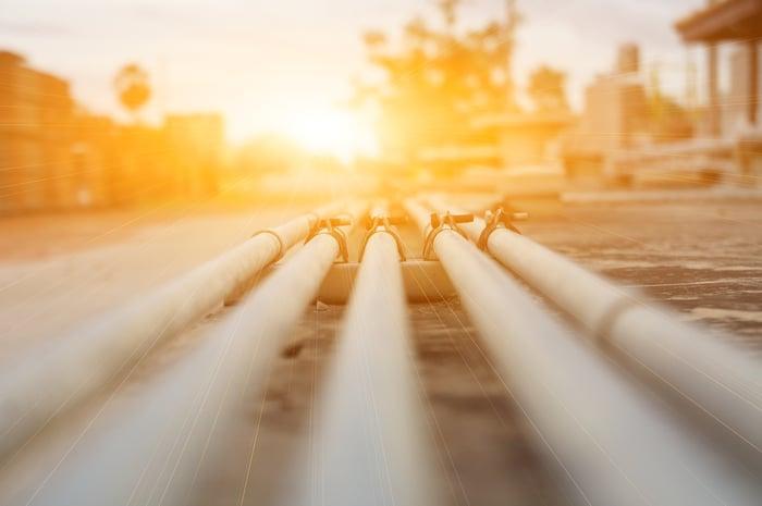 A burst of sunlight shining on a pipeline.