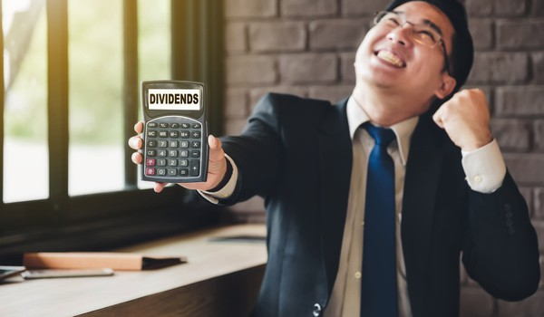 guy-super-excited-about-dividends-getty