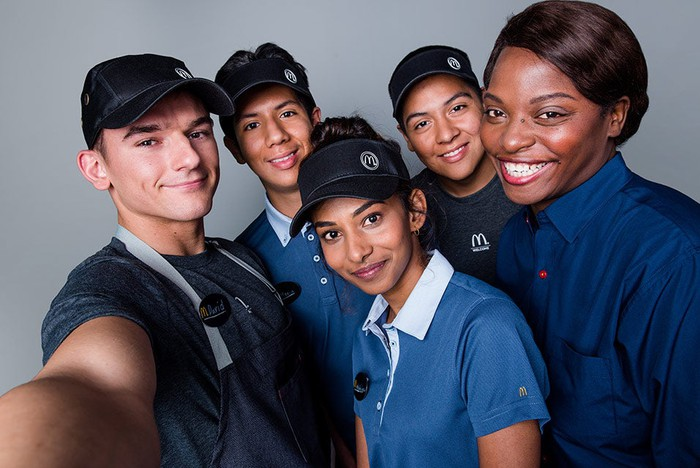 Smiling McDonald's employees.