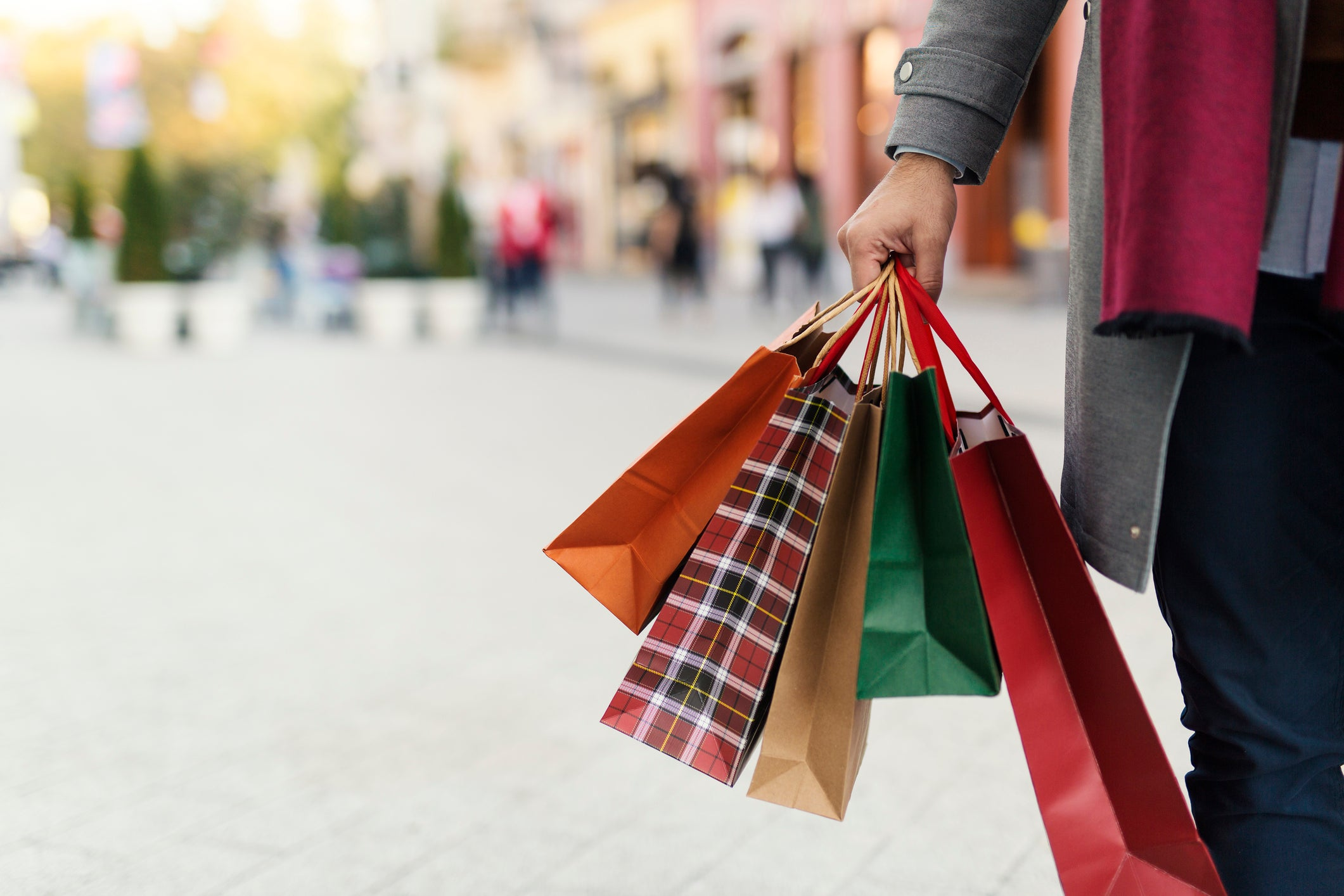 Image of person holding shopping bags.
