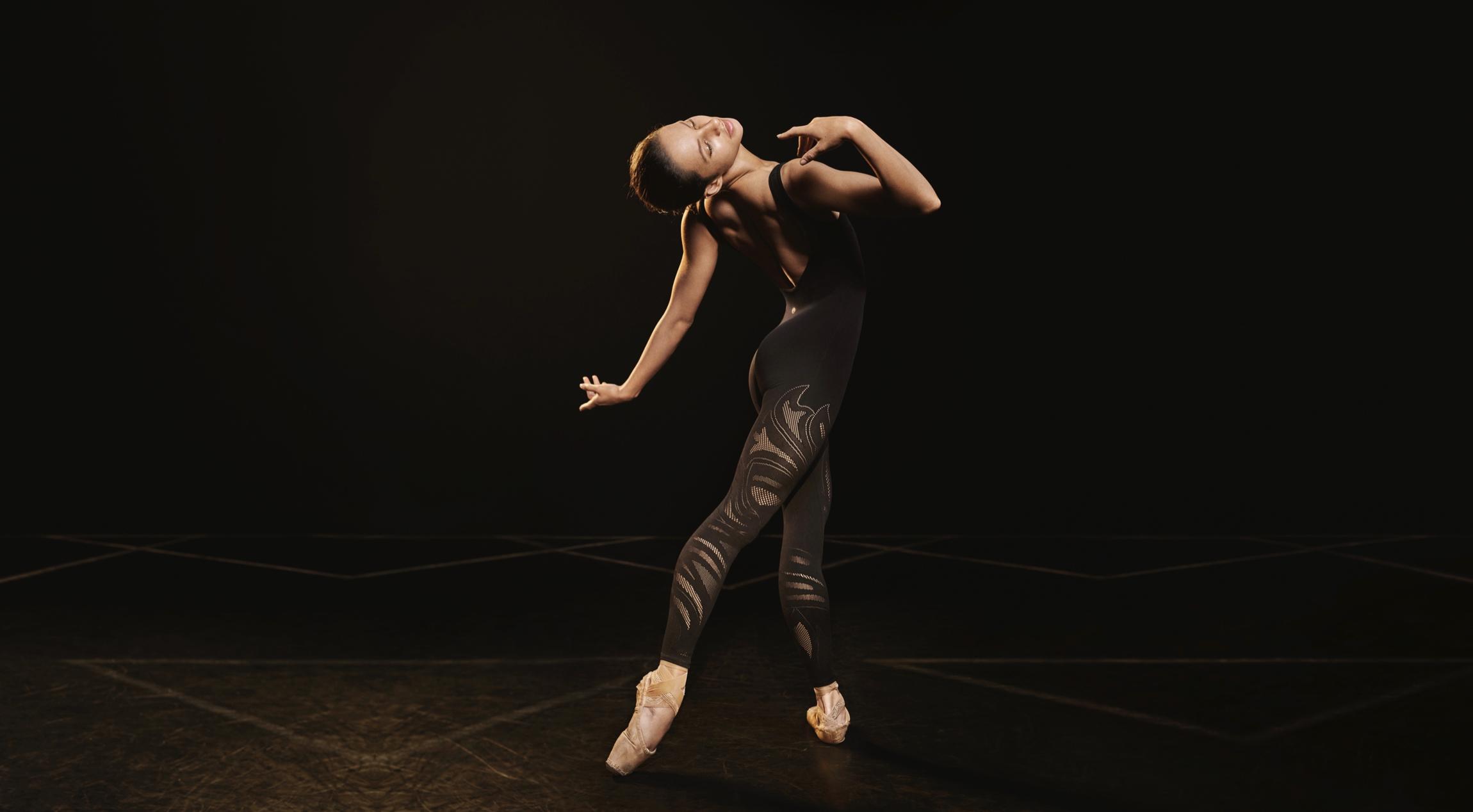 Ballerina Francesca Hayward dancing while wearing Lululemon apparel.