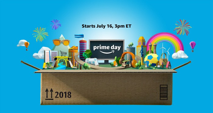 """An computer-generated image of an Amazon box opening with a multitude of items coming out and a sign the says, """"Prime Day. Starts July 16, 3PM Eastern Time."""""""