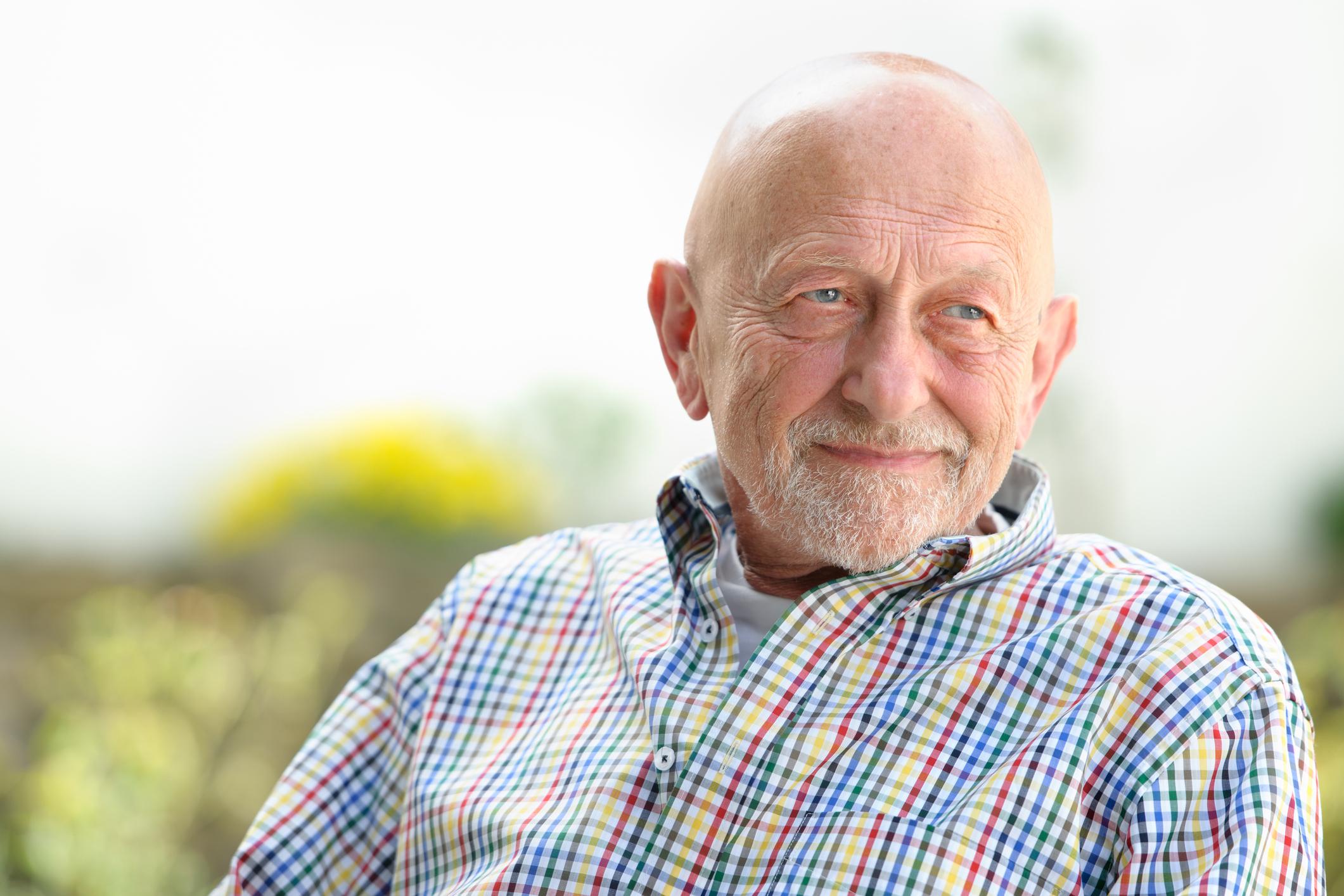 Smiling senior man outdoors