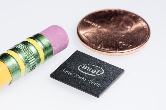 An Intel XMM 7560 modem next to an eraser and a penny.