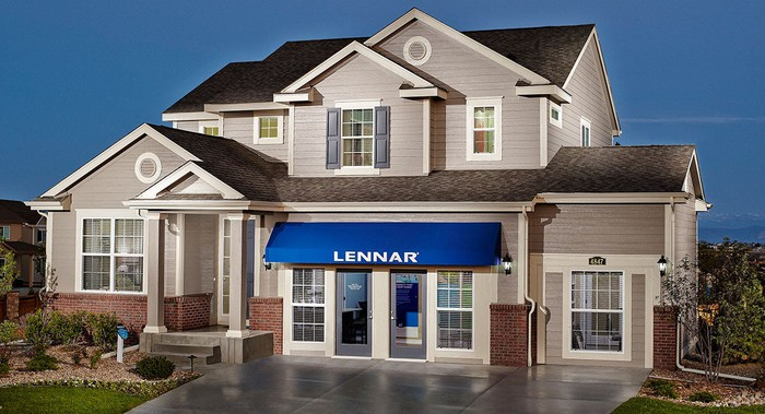 A Lennar sales office lit up at night.