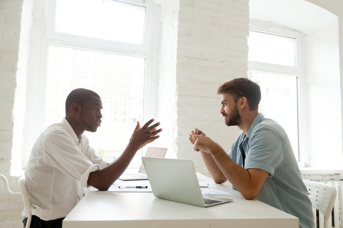 Two professional men talking.