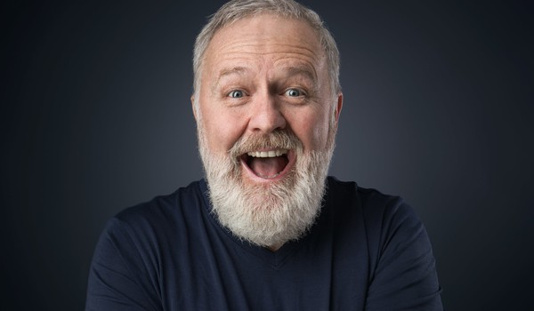bearded older man with big smile_GettyImages-902012616