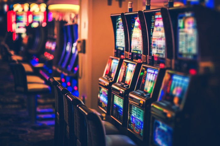 A row of slot machines in a casino