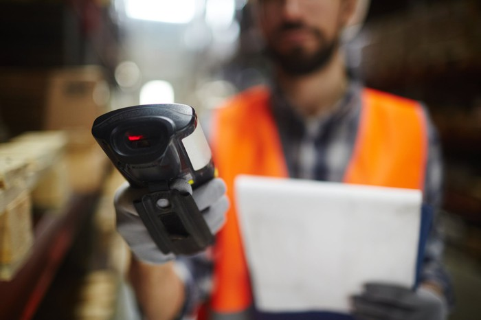 A warehouse worker with a scanner