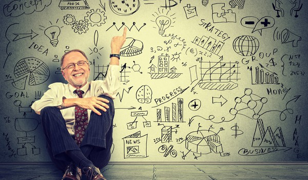 man sitting pointing upward at clock GettyImages-512536952