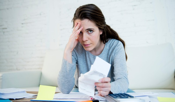 woman stressed about bills_GettyImages-540503334