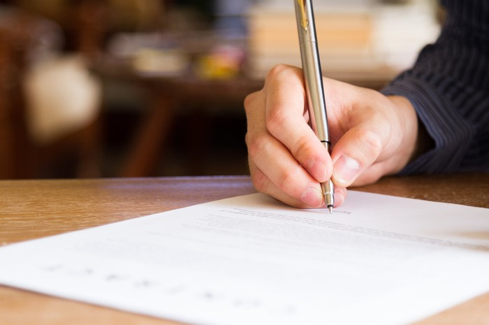 Man filling out a document