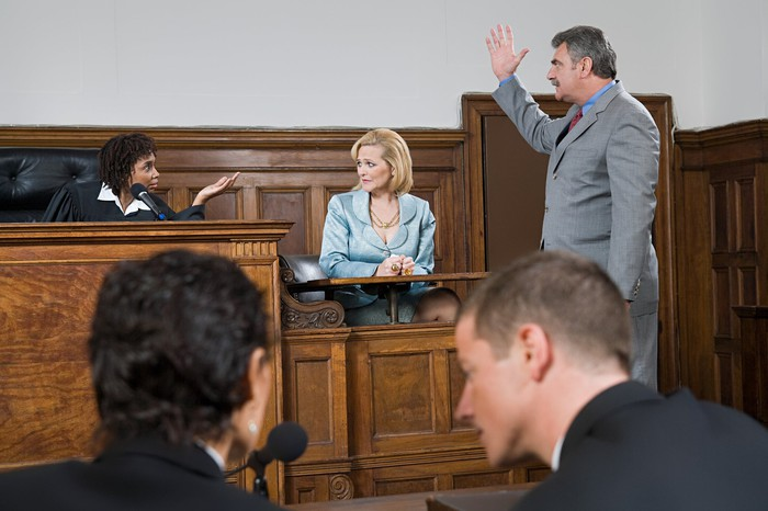 Lawyers arguing in court.
