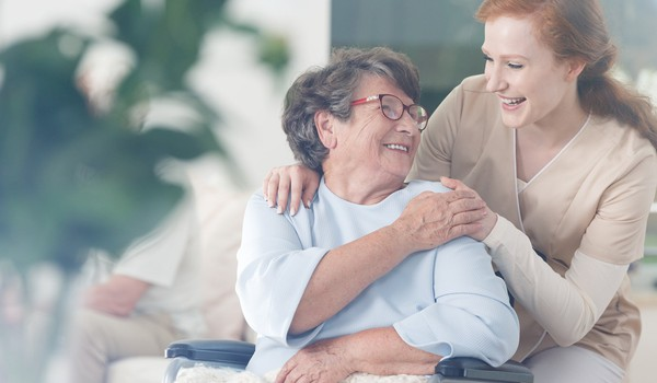 old woman with caregiver_GettyImages-834528752
