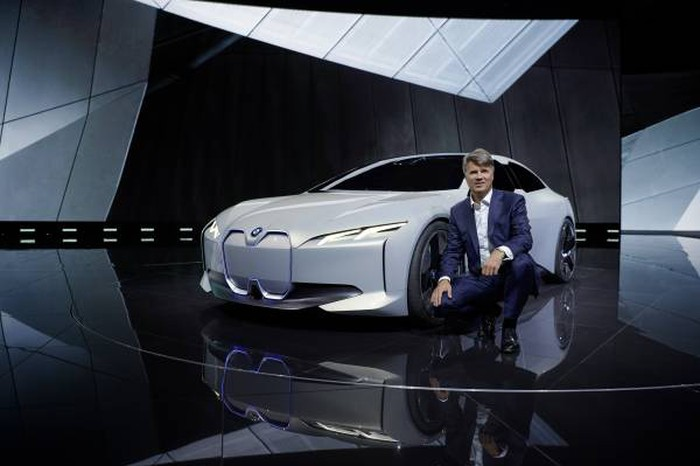 Krueger is shown on an auto-show stand with BMW's i Vision Dynamics concept car, a preview of an electric BMW sedan expected in 2021.