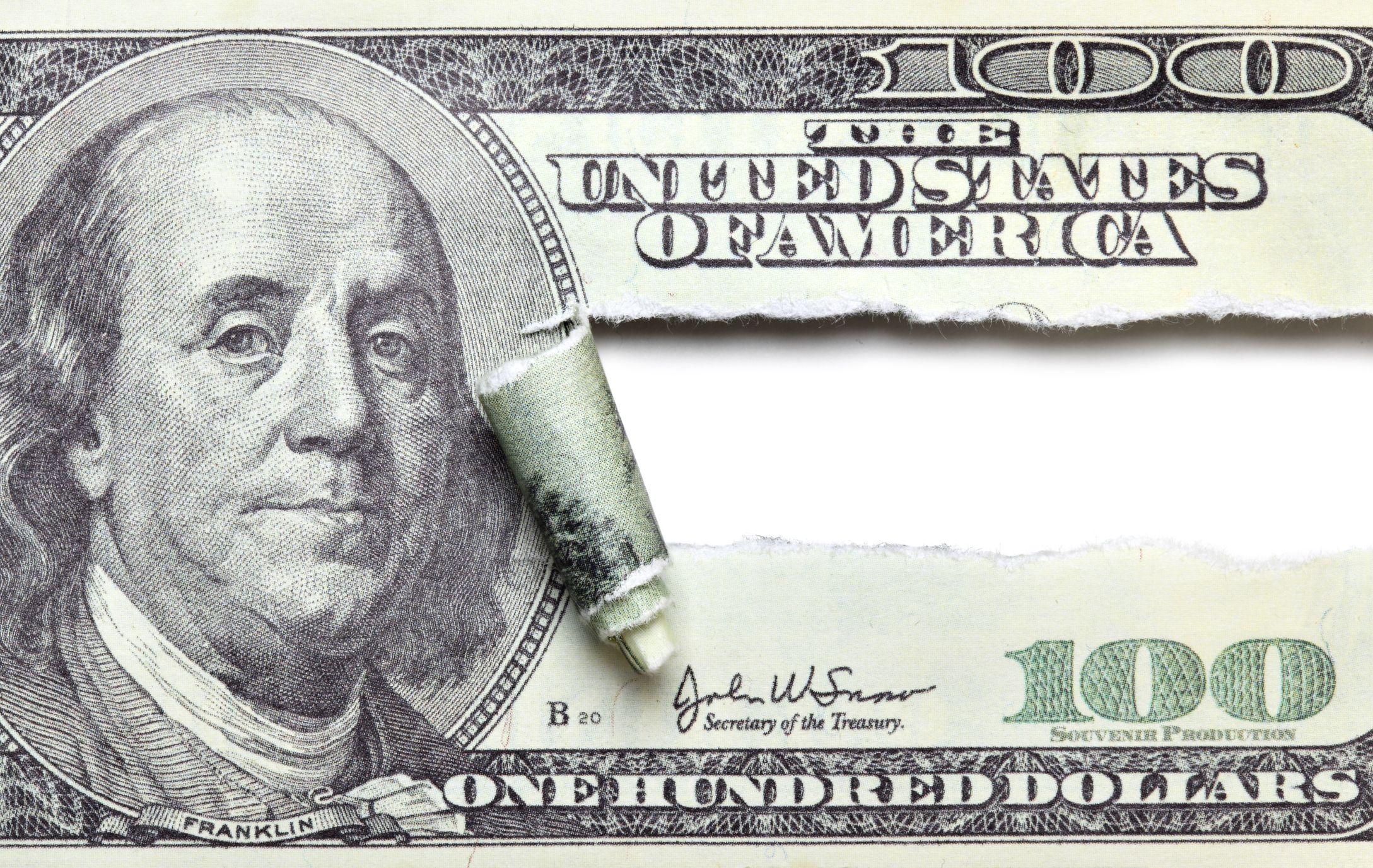 A dollar bill ripped